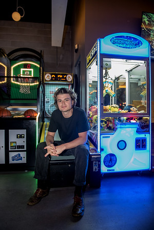 AMANDA SABGA/Staff photo<br /> <br /> Joe Keery, Newburyport native, who plays Steve Harrington on the Netflix original series Stranger Things, poses for a photo at A4cade in Cambridge.<br /> <br /> 6/25/19