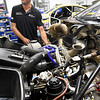 BRYAN EATON/Staff Photo. Race mechanic Paul Raby makes adjustments to a race car that was destined for a meet at the Virginia International Raceway.