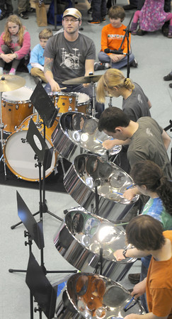 Newburyport: Zach Field, of the Zach Field Drum Studios,leads some of his students in a steel drum demostration at the 6th annual Montessori Family Social at Nicholson Hall in Newburyport Sunday. The musical themed event featured intsrument making , dancing, and a intrsument petting zoo, were kids could check out, brass and woodwinds, ukulels, banjo, and other instruments. Jim Vaiknoras/staff photo