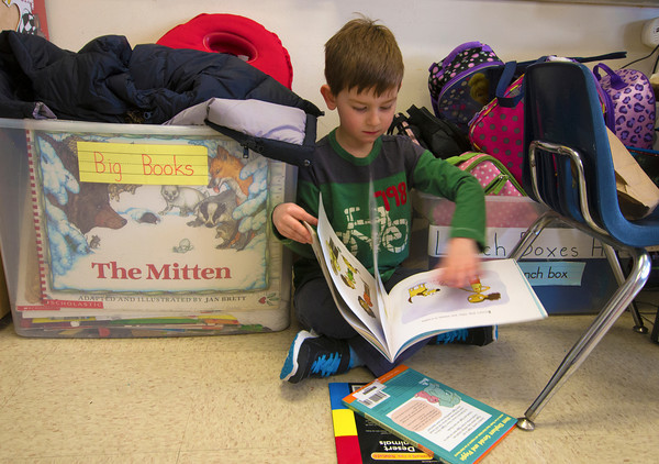 Jack Oreal reads a book in Melissa Duguie's kindergaten class