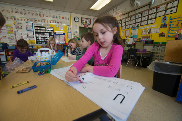 Eve LeBlanc works on  her letters  in Melissa Duguie kindergarten at the Brown School.