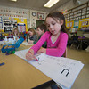 Eve LeBlanc works on  her letters  in Melissa Duguie kindergarten at the Brown School.
