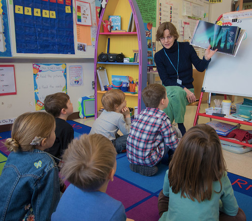 Sheryl Herzig reads to her class at the Brown School