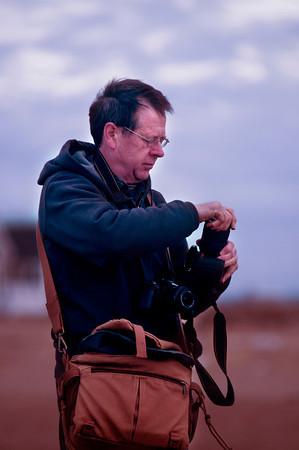 Joe Gerry photographs the sun rising over Plum Island.