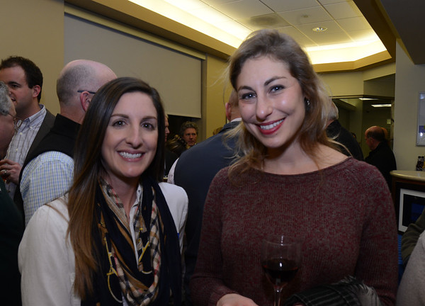JIM VAIKNORAS/Staff photo Kelsy Stromski of Refinery 43  and Graphic Designer and Artist Lia Strasser at the Newburyport Chamber mixer at the Ipswich Savings Bank.