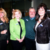 JIM VAIKNORAS/Staff photo KLisa Shank, Hiedi Jackson Dean, Michael Moscone and Nancy Furnari of the Ipswich Savings Bank at the Newburyport Chamber mixer at the Ipswich Savings Bank.