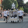Newburyport: The Holy Rollers from The Old South Church heads down Federal Street Thursday night. They were one of 5 competing in the annual Yankee Homecoming Bed Race Thursday night. Jim Vaiknoras/photo 2009