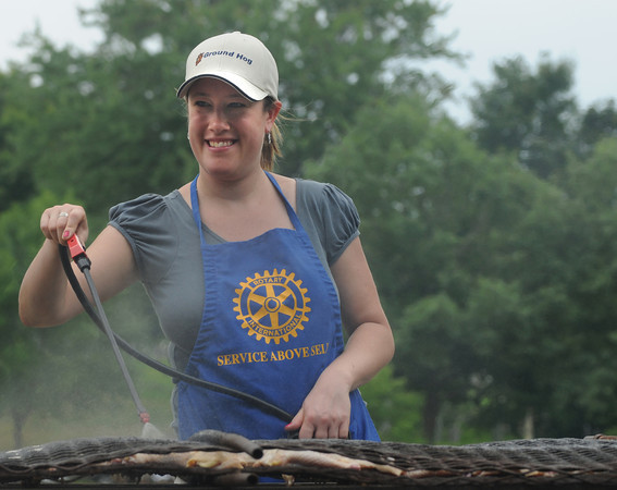 Newburyport: The Rotary Clubs Kate Kelly uses a sprayer to apply sauce to chicken at the annual Rotary Club Chicken and Rib BBQ at Olde Fashioned Sunday on the Mall Sunday. Jim Vaiknoras/Staff photo 2009