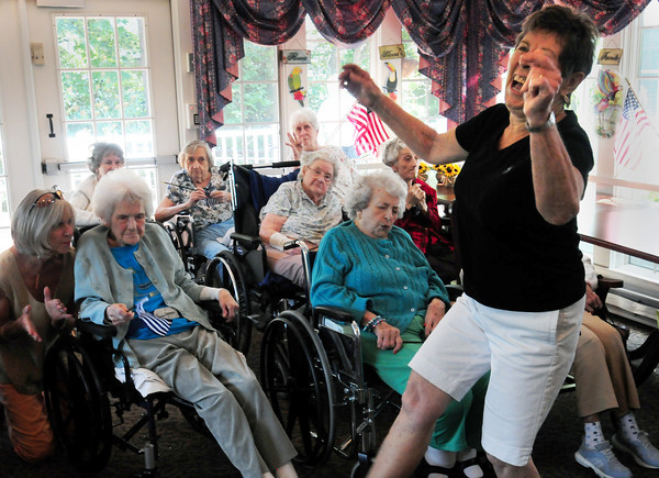 Newburyport: Phyllis Packer, visiting the Brigham Manor, dances to the music of the Dick Kaplan Excellent Jazz Band in the Nursing Home Concert Series. Bryan Eaton/Staff Photo 2011
