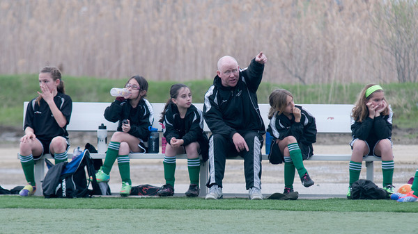 Tosh Farrell with his U10 girls team at Amesbury Park