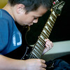 Michael Roberts, 12 , of Georgetown, practices in the waiting room at the West Newbury Music School.