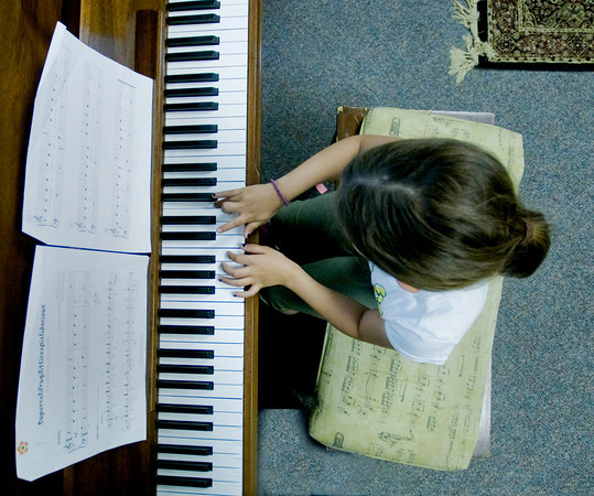 Lexi Roberts, 8, playes piano at the West Newbury Music School.