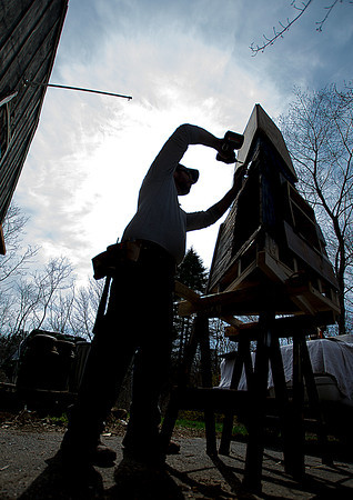 Artist Sean Bixby works on the Pentucket Arts project at his Merrimac home.