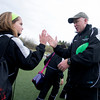U10 player Livia Palmer high fives Coach Tosh Farrell after their game at Amesbury Park.