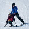 Todd Clark  guides  student Catherine Faherty on a monoski at Loon Mountain