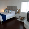 JIM VAIKNORAS/Staff photo One of the bedrooms at Blue, The Inn on The Beach on Plum Island.