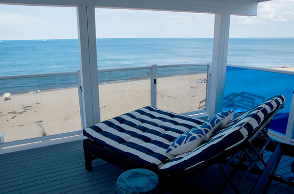 JIM VAIKNORAS/Staff photo A chaise lounge on one of the balconies at Blue, The Inn on The Beach on Plum Island.