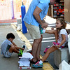 JIM VAIKNORAS/Staff photo Will Doherty helps his kids Maddox and Piper both 6 at Hyman's in Newburyport.