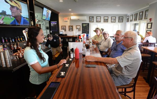 BRYAN EATON/Staff Photo. Bartender Emilee Elliott oversees her regular customers.