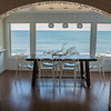 JIM VAIKNORAS/Staff photo The dinning area with an ocean view in the Blue Suite at Blue, The Inn on The Beach  on Plum Island.