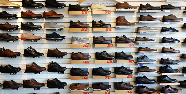 BRYAN EATON/Staff Photo. The selection of shoes is extensive at Hyman's Pennyworths.