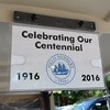 BRYAN EATON/Staff photo. Signs on the golf carts show the 100th anniversary.