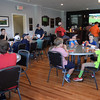 BRYAN EATON/Staff Photo. Youngsters attending a golf clinic by pro Jim Hilton break for lunch.