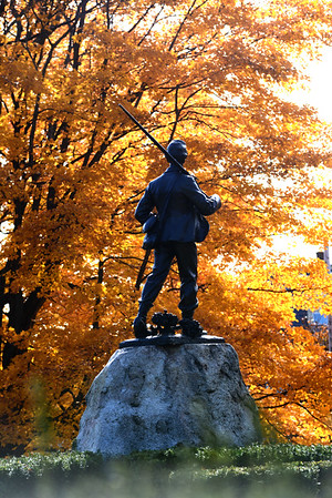 JIM VAIKNORAS/Staff photo <br /> Changing colors frame the Civil War Statue at Atkinson Common in Newburyport.