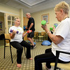 BRYAN EATON/Staff photo. Jill Ramsdell with Patricia Busch doing curls.