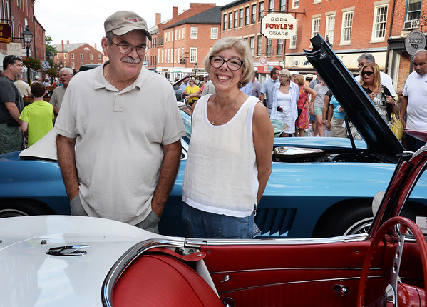 BRYAN EATON/Staff photo. Neil and Judith Sullivan of Ipswich check out a 1962 Corvette.