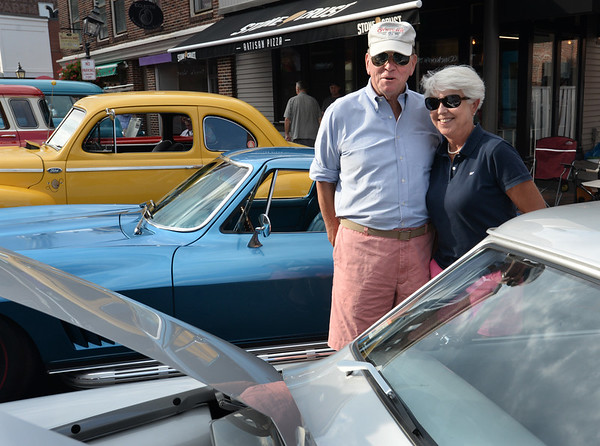 BRYAN EATON/Staff photo. Moss Quinlan of Newbury, who comes to the show every year, with Boni Morse, also of Newbury, like a 1955 Studebaker.