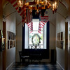 JIM VAIKNORAS/Staff photo A light house light and Coast Guard flags greets visitors to the Custom House.