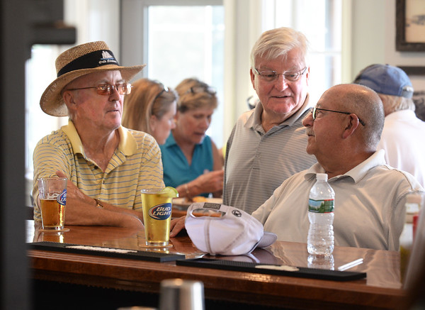 BRYAN EATON/Staff Photo. Regulars meet at the renovated pub, from left, past president Ed Shea, Peter Clay and Roger Fuller all of Newburyport.
