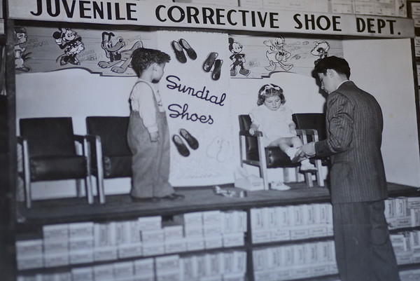 JIM VAIKNORAS/ Staff photo Kids try on shoes at Hyman's in a photo from the 1950's.