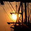 JIM VAIKNORAS/Staff photoThe sun sets behind El Galeon as it rest along teh Newburyport waterrfront in the Merrimack River.