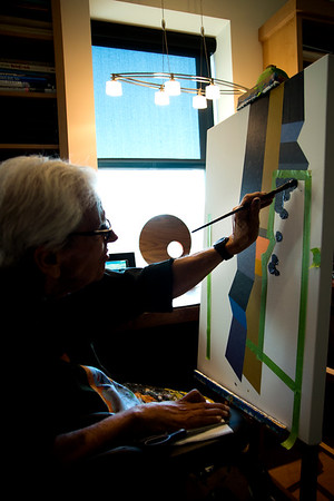 JIM VAIKNORAS/Staff photo Ron Emmerling uses his left hand to paint at his Newburyport home.