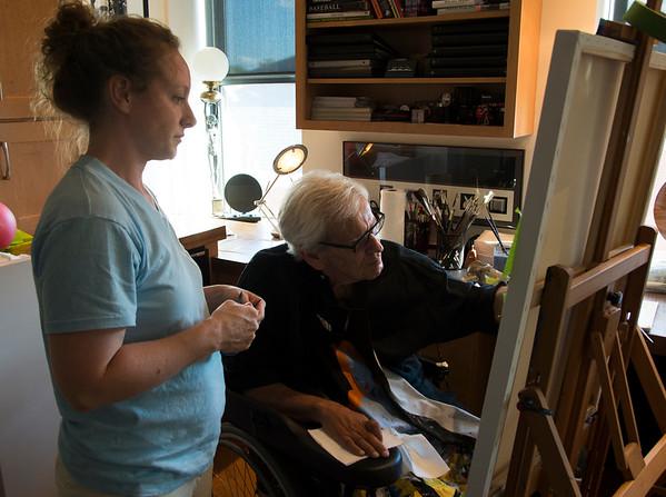 JIM VAIKNORAS/Staff photo Laura Cassen helps  Ron Emmerling as he paints at his Newburyport home.