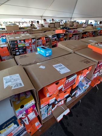 JIM VAIKNORAS/Staff photo Merchandise fills the parking lot at the annual sidewalk sale at Hyman's in Newburyport.