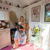 JIM VAIKNORAS/Staff photo Kim Richards on at her she shed on Plum Island with her dogs Karma and Luna.