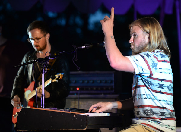 BRYAN EATON/Staff Photo. Chris Plante gestures to the audience at the Yankee Homecoming Waterfront Concert Series.