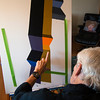 JIM VAIKNORAS/Staff photo Ron Emmerling works on a painting at his Newburyport home.