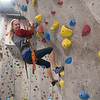 JIM VAIKNORAS/Staff photo Makayla Vigneaux, 13, shows off her climbing skills at the Girls Rock Climb-A-Thon to benefit Girls Inc. of the Seacoast Area, a program of the Jeanne Geiger Crisis Center at Metro Rock Climbing in Newburyport.