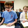 JIM VAIKNORAS/Staff photo Nate Hall, 13, and Theo Roberts, 10, rehearse with the Greater Newburyport Children's Choir at the Hope Church in Newburyport.