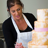 JIM VAIKNORAS/Staff photo Jenny Williamson adds a boarder to one of her cakes at her bakery in Amesbury.