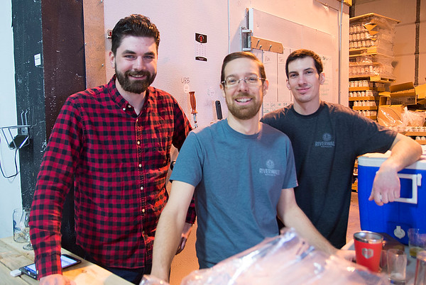 JIM VAIKNORAS/Staff photo Jamie Danahy, owner Steve Sanderson, and Andrew Silva at the Riverwalk Brewery in Newburyport new brewery unvailing.