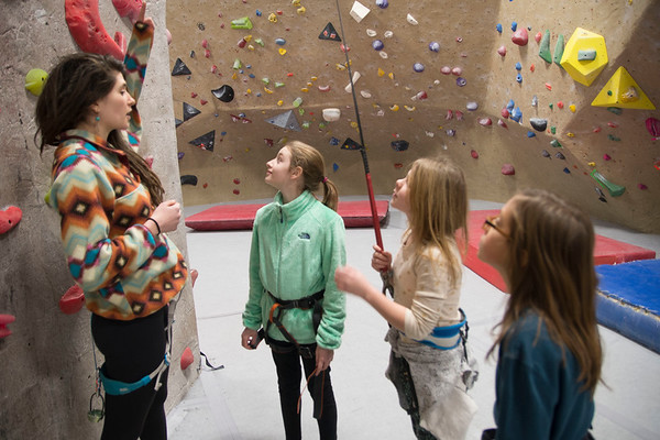 JIM VAIKNORAS/Staff photo Mackenzie Mitchell of Somerville explains the safety rules to Caroline Metzdorf, Hannah Wilcox and her sister Sophia Wilcox at the Girls Rock Climb-A-Thon to benefit Girls Inc. of the Seacoast Area, a program of the Jeanne Geiger Crisis Center at Metro Rock Climbing in Newburyport.