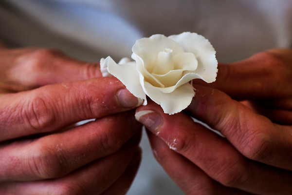 JIM VAIKNORAS/Staff photo Jenny Williamson makes a rose out of gumpaste at her bakery in Amesbury.