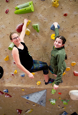 JIM VAIKNORAS/Staff photo Lauren Kolman, 13, and Ameilia Taylor, 11, at the Girls Rock Climb-A-Thon to benefit Girls Inc. of the Seacoast Area, a program of the Jeanne Geiger Crisis Center at Metro Rock Climbing in Newburyport.