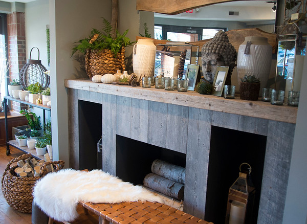 JIM VAIKNORAS/Staff photo Custom fire place made from reclaimed wood at Sage Design.