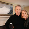 BRYAN EATON/Staff photo. Steve and Linda Blackwood pose under one her painting in their Newburyport home.